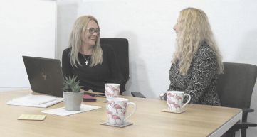 Two ladies looking at each other, The team behind Flamingo Marketing Consultancy Coventry