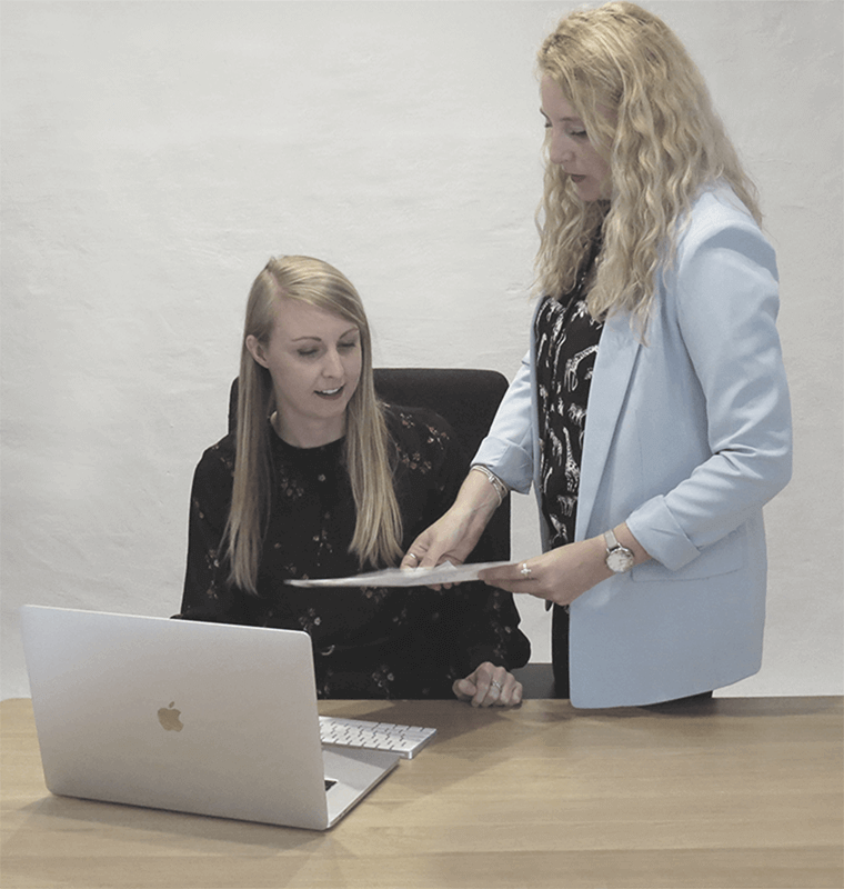 Two consultants looking at a laptop for Social Media Marketing in Warwickshire