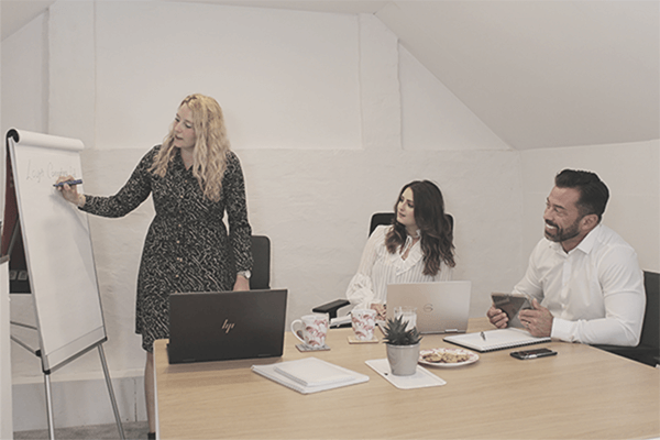 Woman presenting to 2 members of staff at Marketing agency Leamington Spa